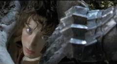 Frodo hiding from the Ringwraith; Merry and Frodo discussing Strider.